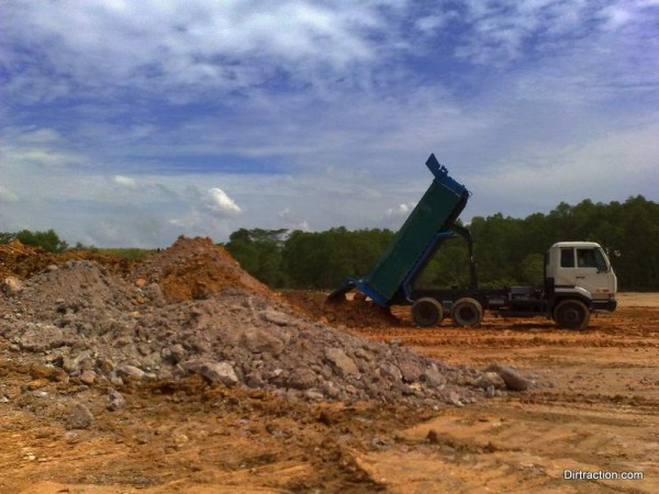 hundreds of load of soil for the start hill and turn 1