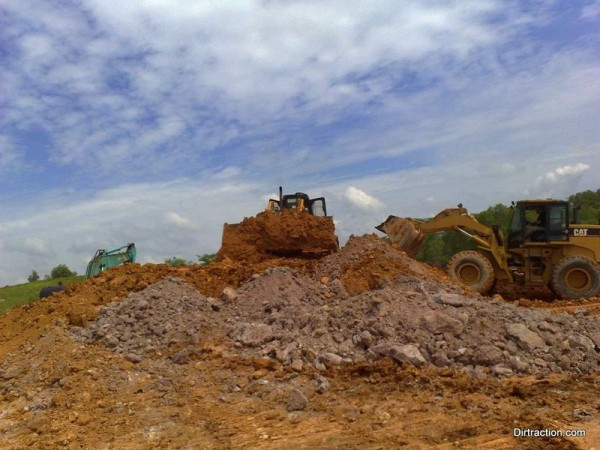a team of dozer working concurrently, with Tom operating the Cat
