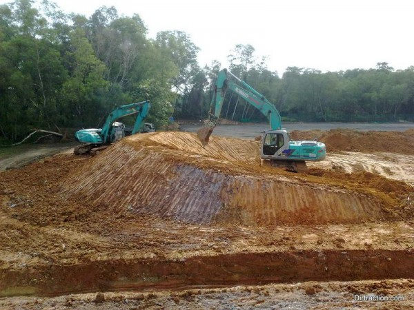 excavator shaping the berms